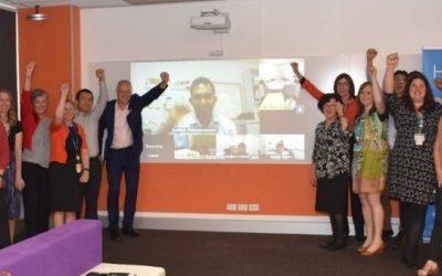 Queensland Health employees celebrate CHIA success